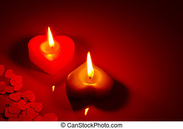 Two burning heart shaped candle