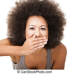 Laughing - Afro-American young woman covering face with her...