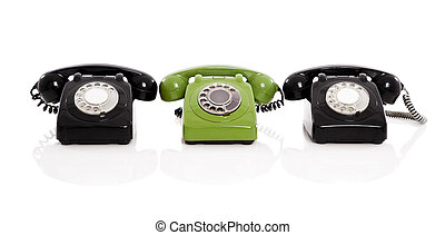 Vintage phones - Green phone in the midle of two black...