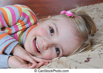 little girl - Beautiful little girl lying on bed at house