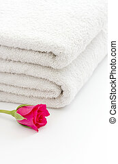 White towels and red rose spa concept