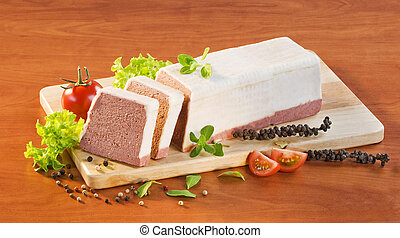Liver pate coated with fat on a cutting board