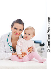 Portrait of pediatrician doctor with baby
