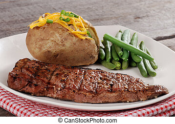 barbecue steak with vegetabes