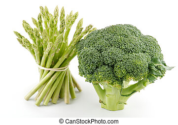 Asparagus sprouts and broccoli floret isolated on white...