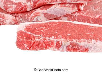 Raw strip loin steaks - closeup Raw strip loin steaks