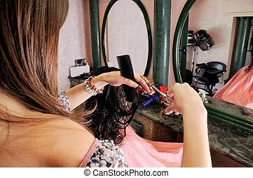 Hair saloon - Hairdresser cutting hair in the hair salon