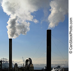 Twin Smoke Stacks - Two smoke stacks with the right side...