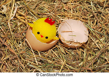 Toy chick hatching