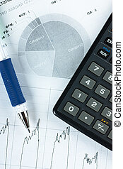 Accounting - Top view of annual report, calculator and pen