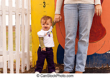 Child Height Measure - Small childs height being measured at...