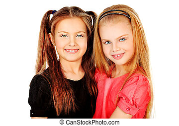 daughters - Portrait of two little girls sisters posing at...