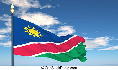Flag Of Namibia on the background of the sky and flying...