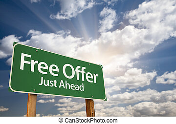 Free Offer Just Ahead Green Road Sign and Clouds