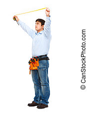 Full length portrait of construction worker measuring with ruler