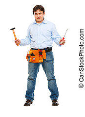 Full length portrait of construction worker with hammer and screwdriver