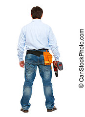 Full length portrait of construction worker standing back to camera