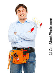 Portrait of construction worker with painting brush