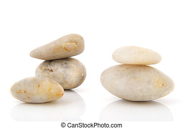 White pebbles - Stacked white pebbles isolated over white...