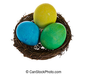 Small birds nest with three Easter eggs