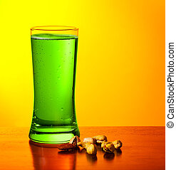 Green beer and nuts - Glass of cold green Irish beer drink...