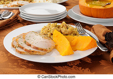 Thanksgiving dinner - A plate of sliced turkey with...