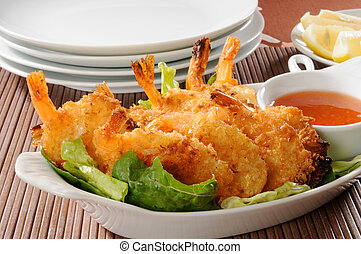 Shrimp appetizer - A platter of coconut shrimp with sweet...