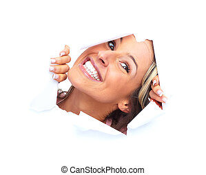 Happy young woman looking through a hole.