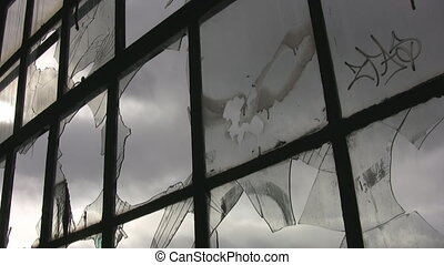 Broken factory window. - A large window at an abandoned...