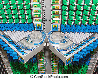 fiber optic rack with high density of blue and green SC...