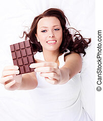 woman with chocolate - beautiful young woman eating...