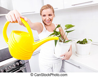 housewife with flowers - beautiful happy young housewife...