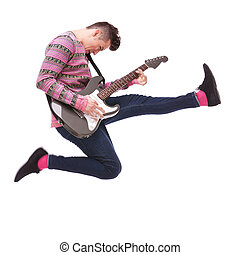 passionate guitarist jumps in the air on white background....