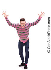 Casual man looking very happy with his arms up, isolated on...