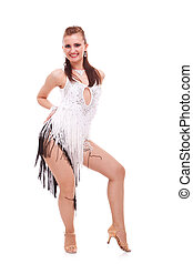 young latino woman dancer posing on white background....