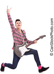 excited rock star with an electric guitar isolated over...