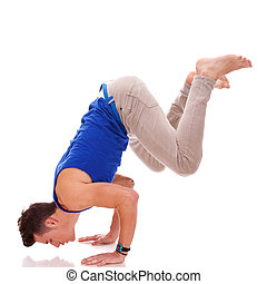barefoot casual man doing a handstand