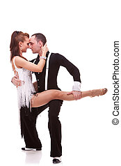 passionate dancing couple on white background. Man holding...