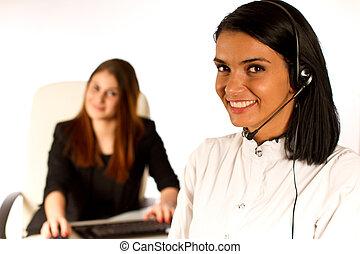 Business women in office - 2 business women, secretaries in...