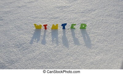 colorful word winter on snow