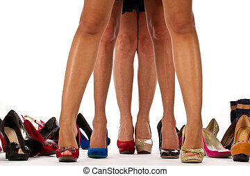 Legs with different shoes high heels