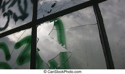 Broken windows. Two shots - Closeup of a broken factory...