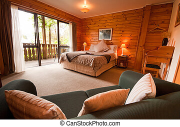 Interior of mountain wooden lodge bedroom - Nice warm...