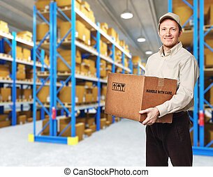 delivery service - smiling delivery man in warehouse