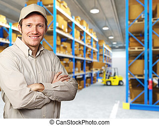 worker in warehouse - smiling delivery man in warehouse