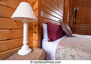 Wooden lodge bedroom interior detail - Detail of mountain...