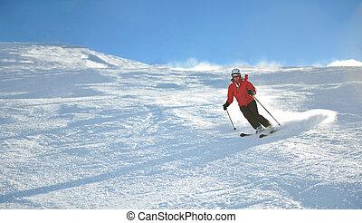 skiing on fresh snow at winter season at beautiful sunny day...