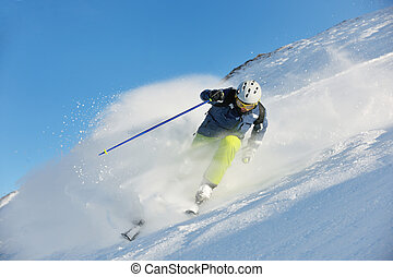 skiing on fresh snow at winter season at beautiful sunny day...