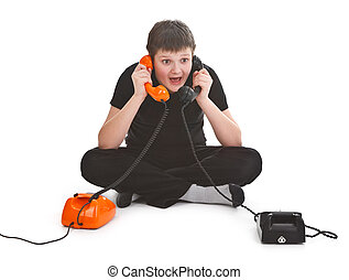 boy having two phone calls at the same time