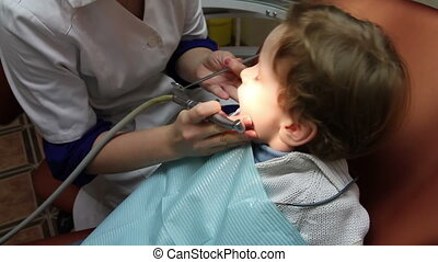 Preventive inspection - Doctor treats tooth decay